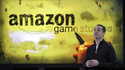 Amazon's vice president of games, Mike Frazzini speaks to media as he displays the Amazon Fire TV during a news conference in New York