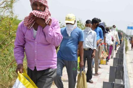 A photograph taken in April 2020: A two-km long food queue in Delhi.