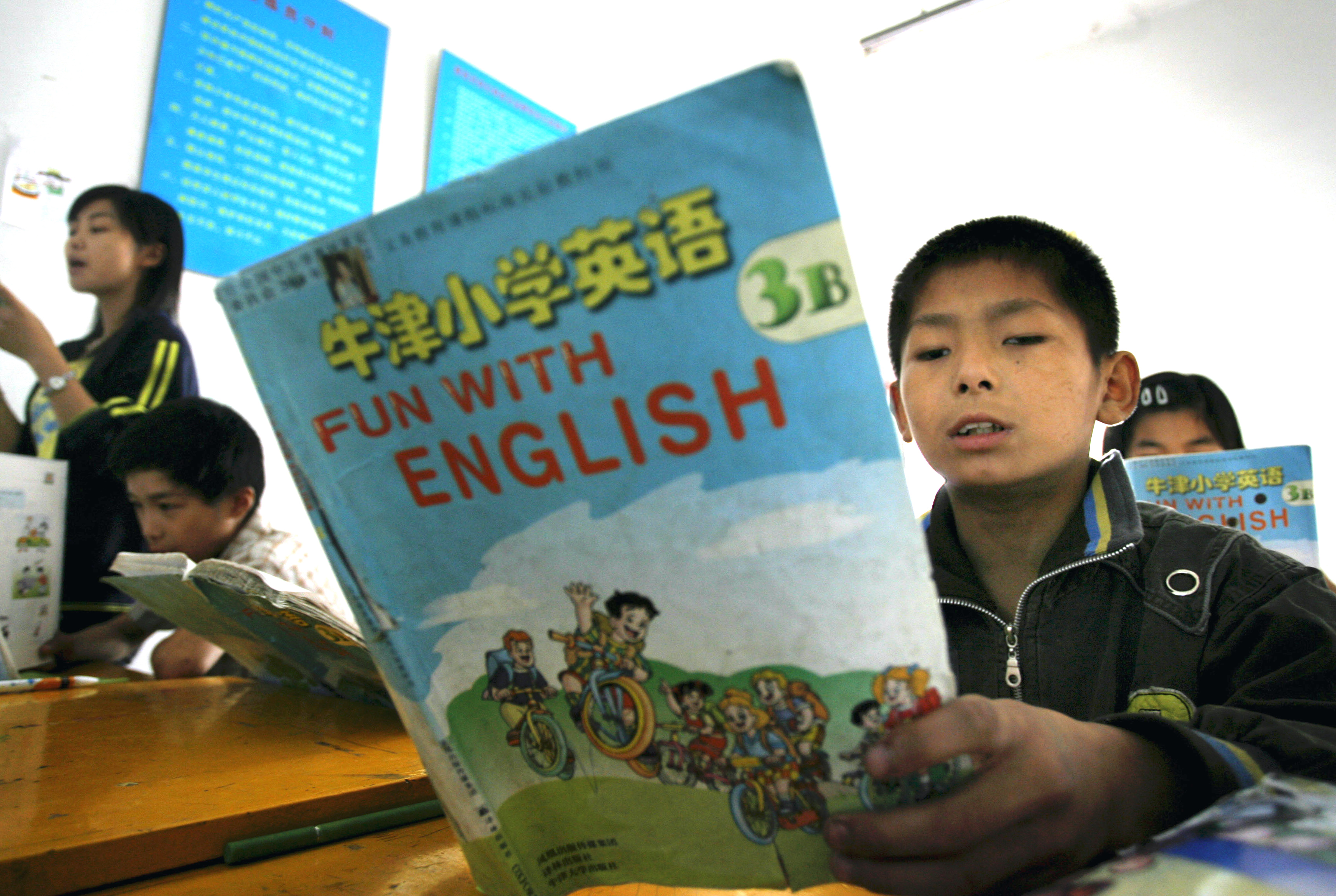 Students learn English during a class at a Wushu school in Longtan county