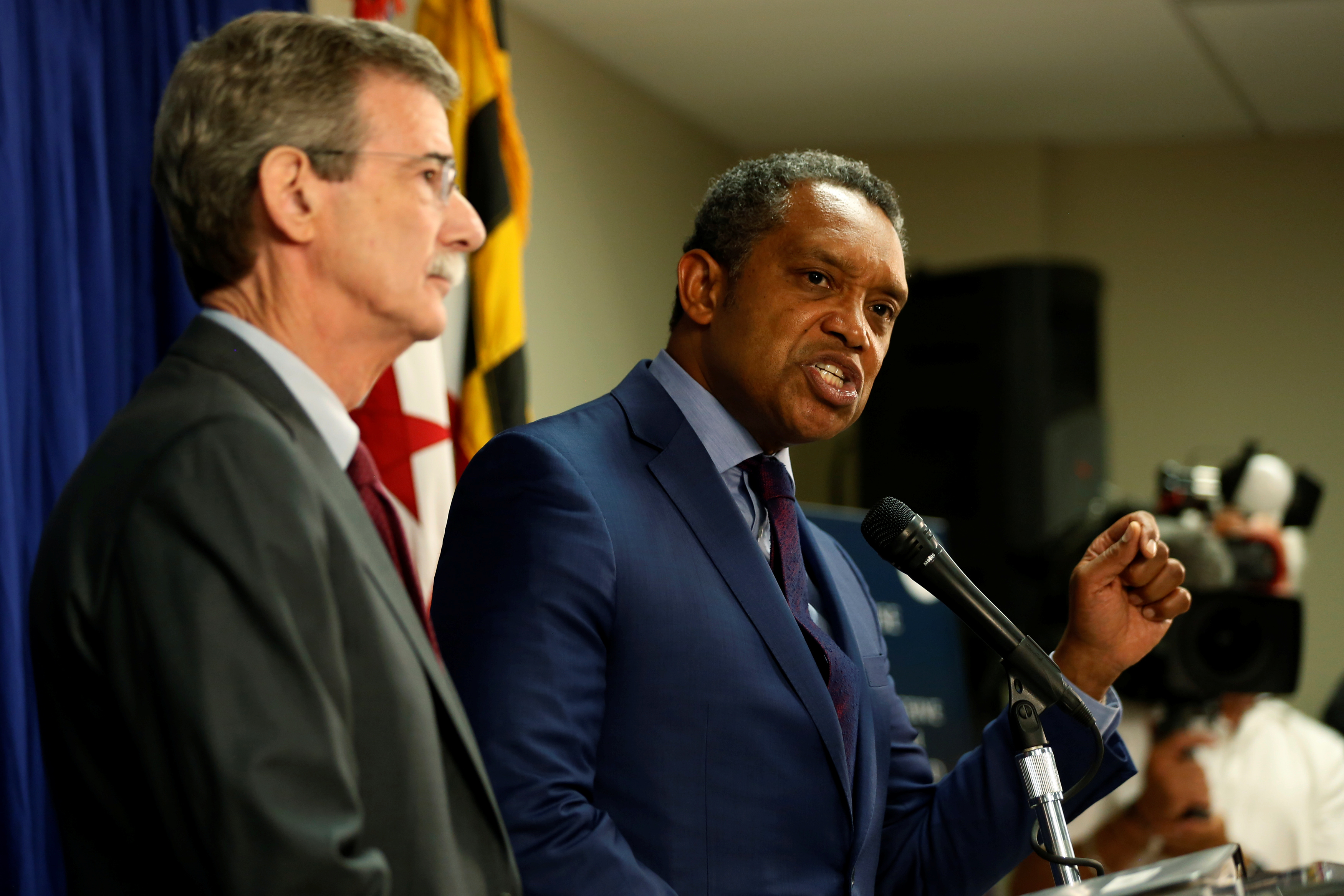 Washington, DC district attorney Karl Racine speaks at a podium during a pre-pandemic press conference.