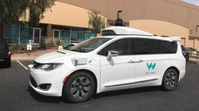 A Waymo self-driving vehicle is parked outside the Alphabet company's offices.