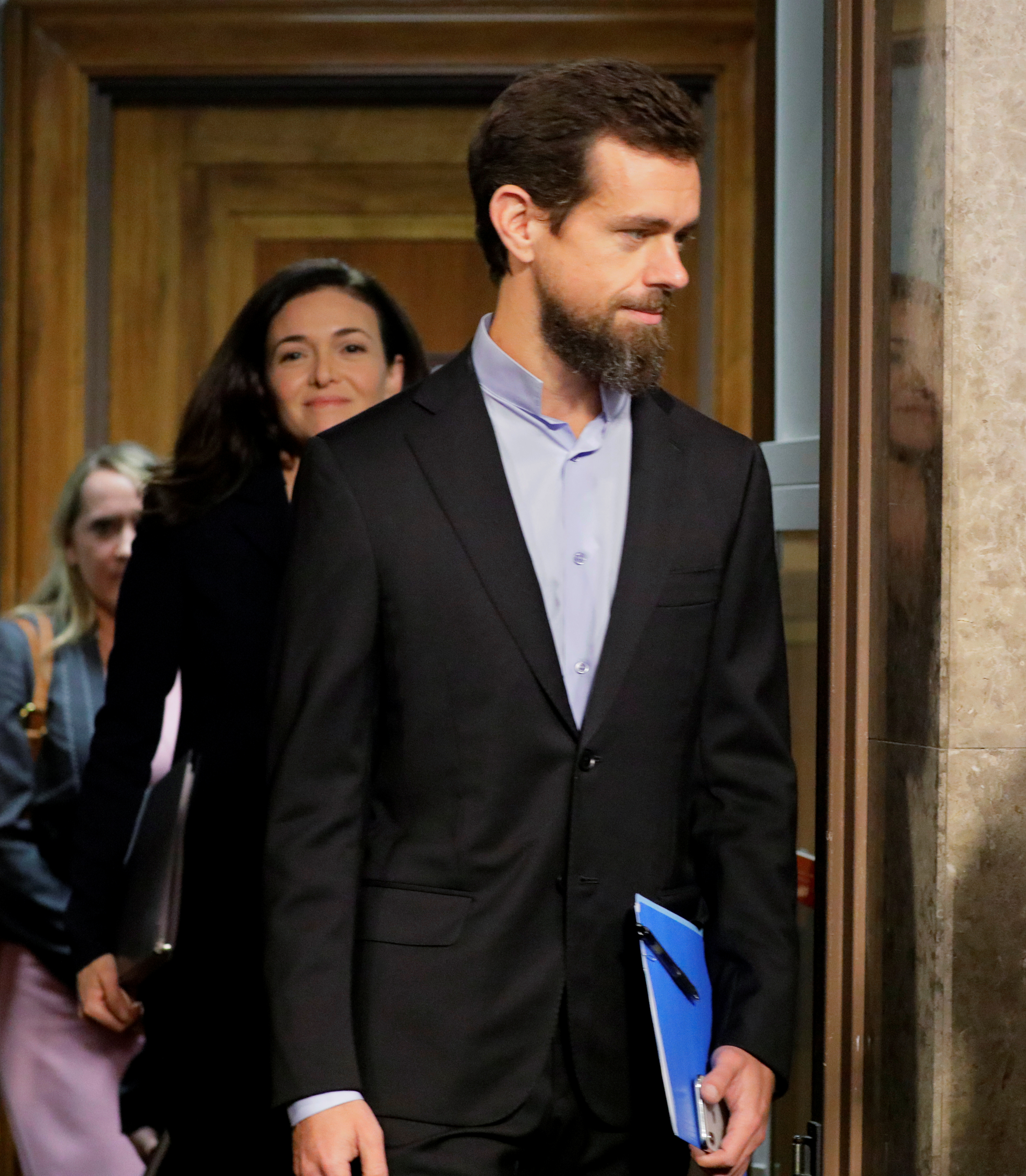 Twitter CEO Jack Dorsey and Facebook COO Sheryl Sandberg arrive to testify before a Senate Intelligence Committee hearing on foreign influence operations on social media platforms on Capitol Hill in Washington, U.S., September 5, 2018.