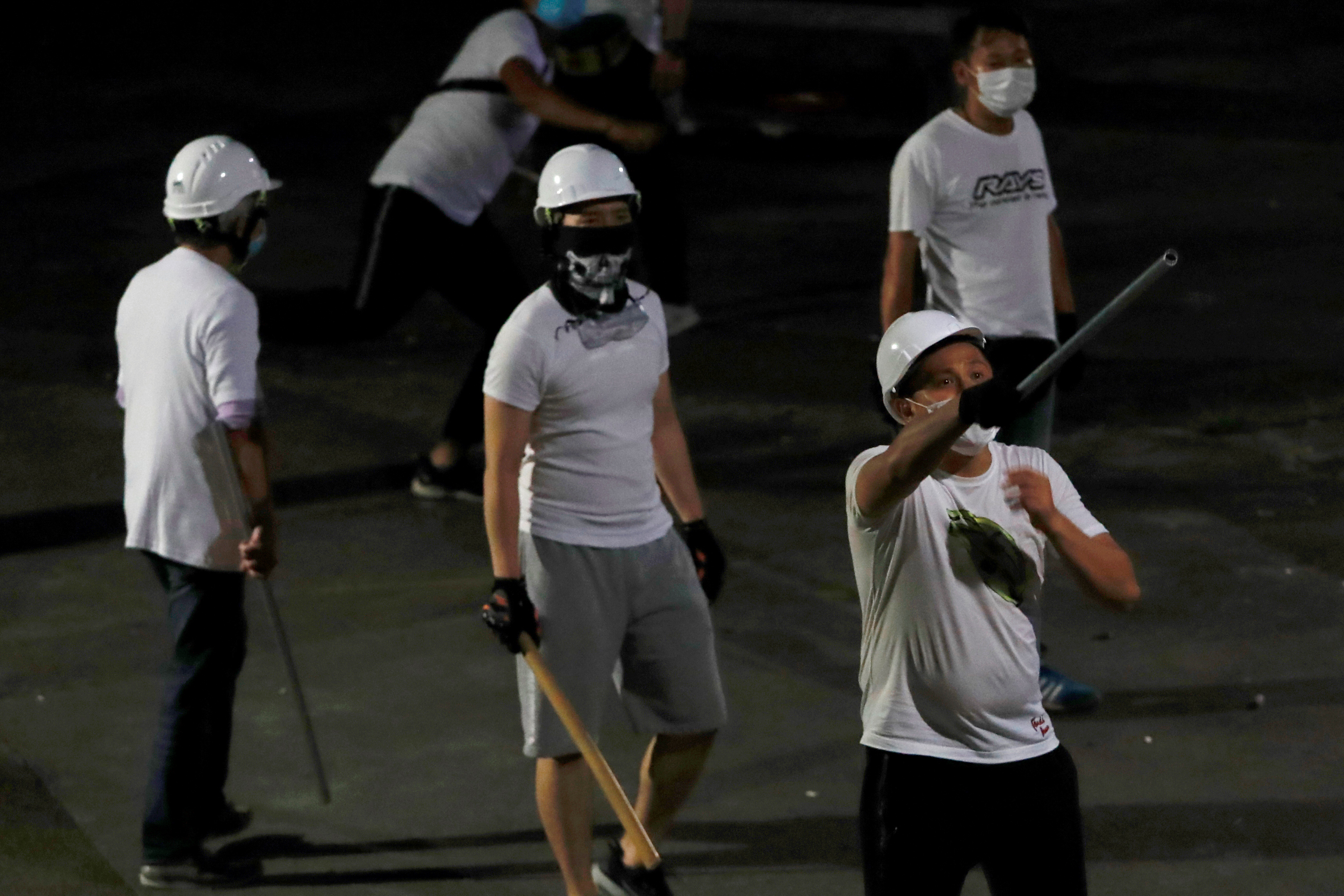 Armed, white-clad men attacked protesters and commuters in Yuen Long, Hong Kong, on July 21, 2019