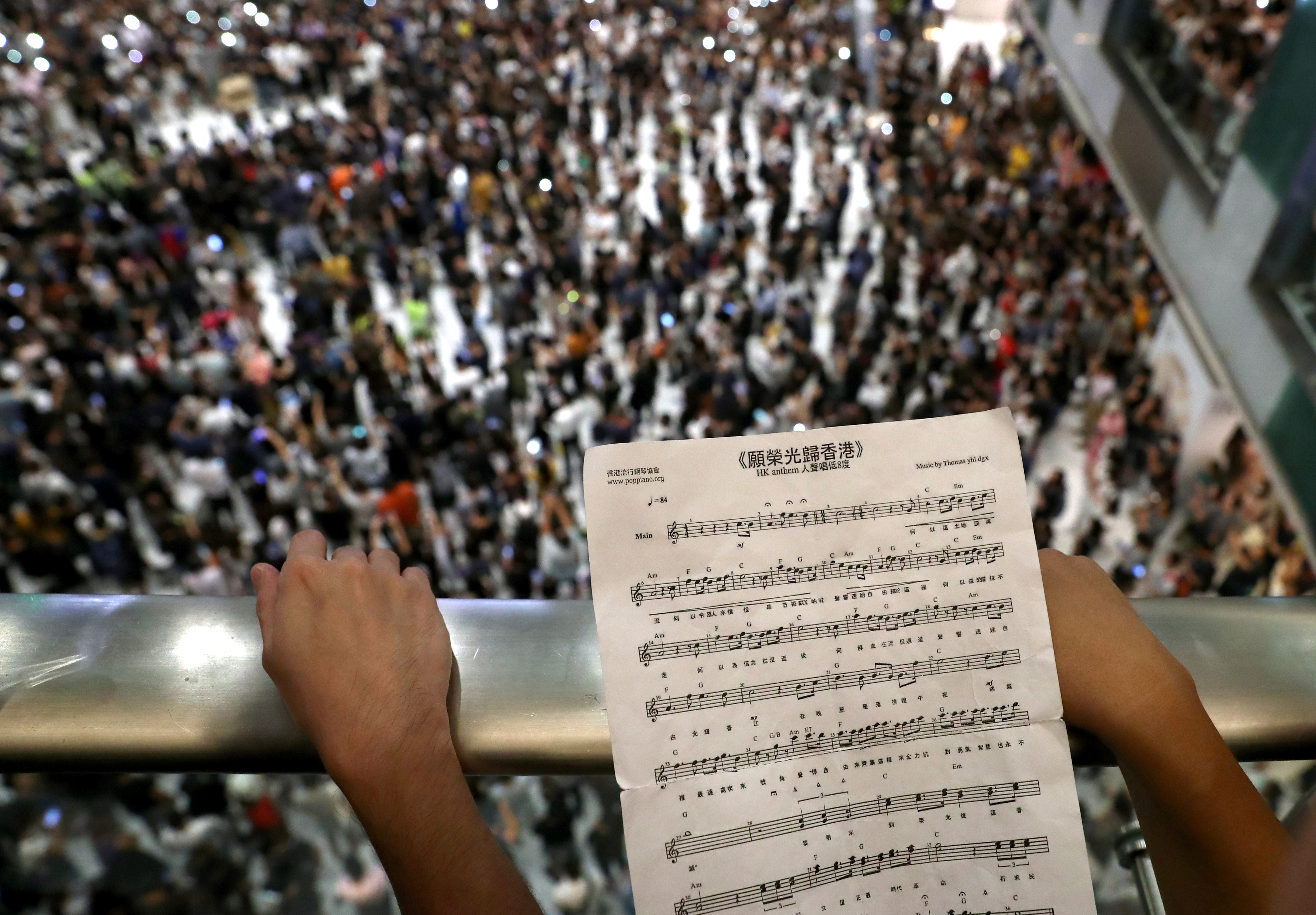 A participant holds sheet music of Hong Kong's protest anthem during a protest in 2019.