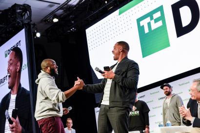 ctor Will Smith shakes hands with a startup representative who won a $10,000 investment from Smith's new VC firm Dreamers Fund at the TechCrunch Disrupt forum in San Francisco