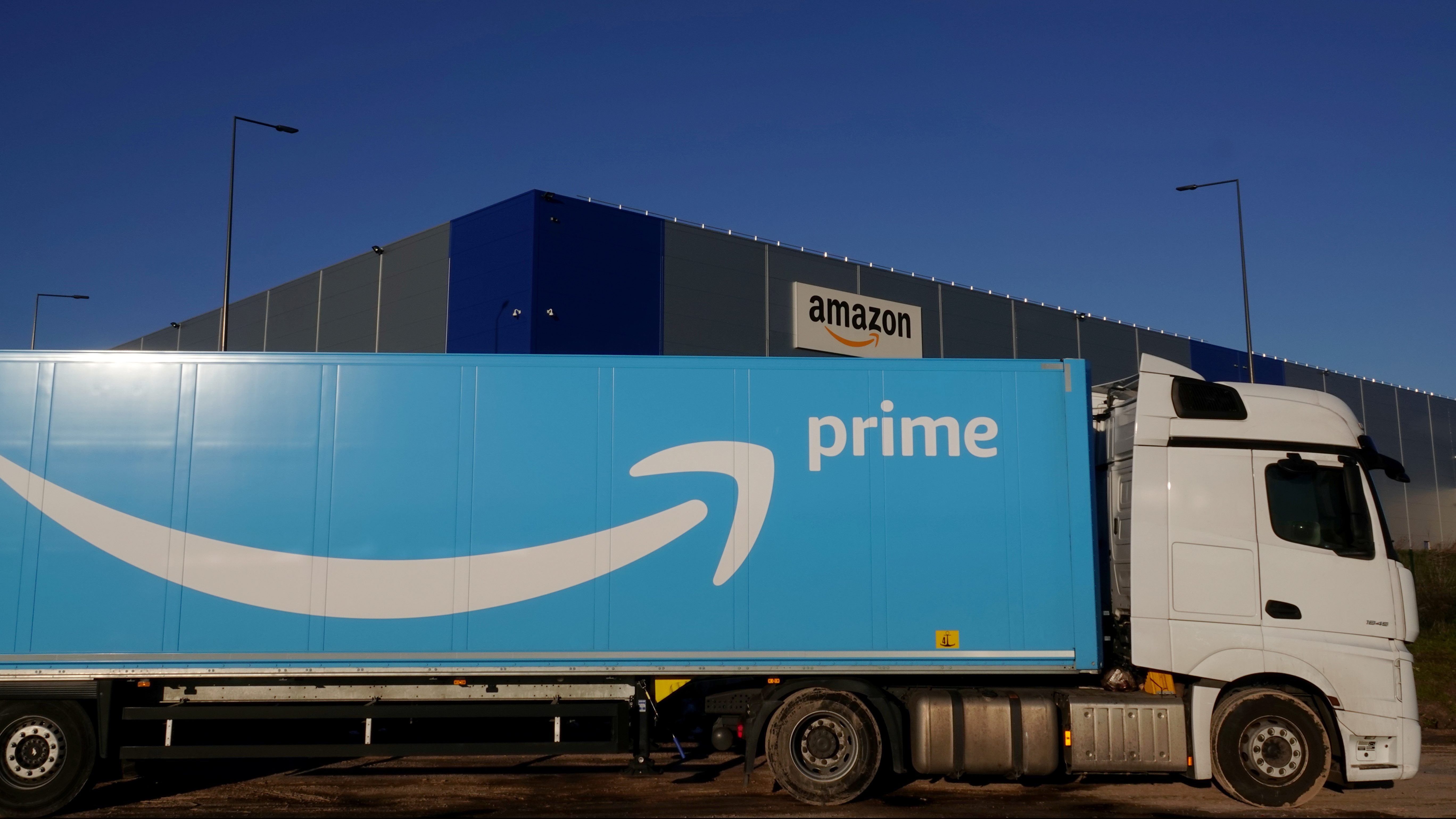 The logo of Amazon Prime Delivery is seen on the trailer of a truck