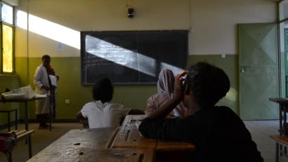 An underage domestic worker takes notes in a class in Addis Ababa, Ethiopia.