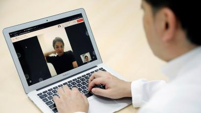 A doctor conducts a telehealth visit