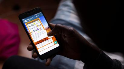 A man uses the Mukuru remittance app, which enables him to send money and groceries home to family in Zimbabwe.