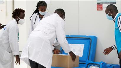 Biomedical engineers pack a consignment of AstraZeneca/Oxford vaccines from COVAX in Nairobi in March.