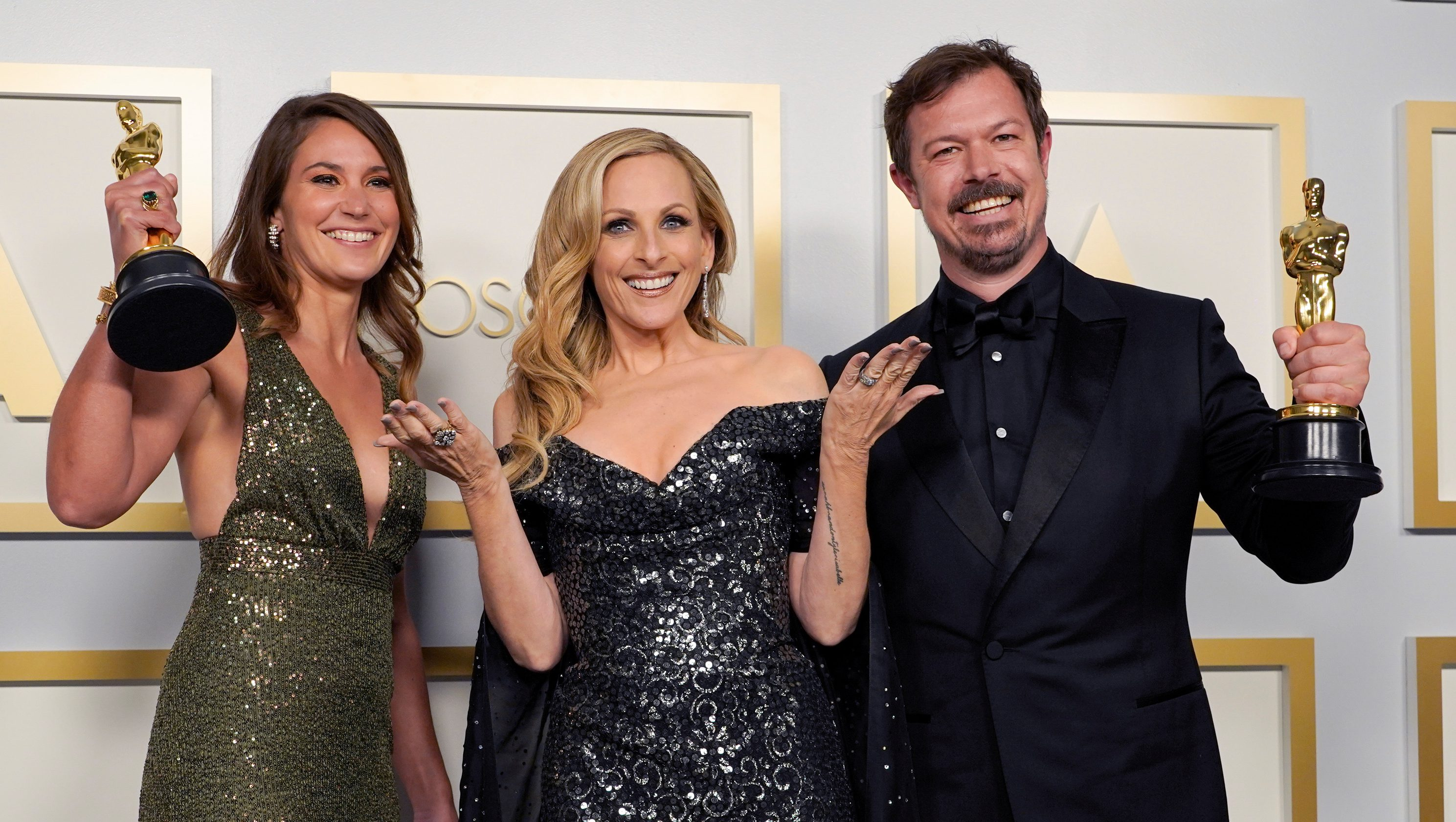 """Pippa Ehrlich, Marlee Matlin, and James Reed, winners of the award for Best Documentary Feature for """"My Octopus Teacher"""" pose at the Oscars on April 25."""