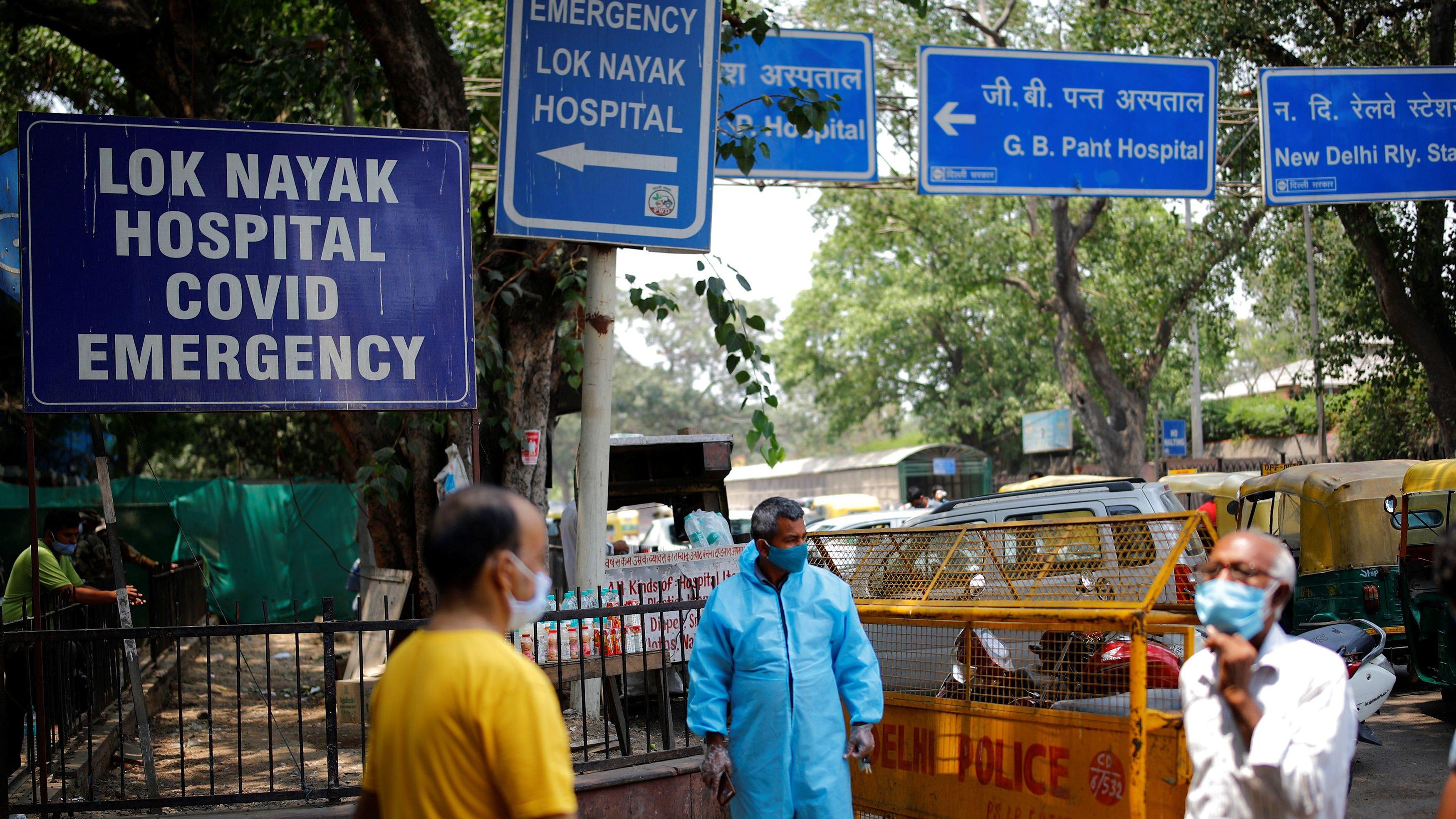 Raj Kumar waits for passengers in New Delhi