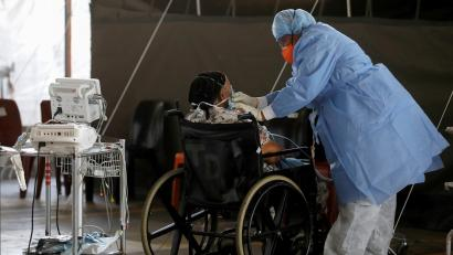 A healthcare worker tends to a patient at a temporary ward set up for Covid-19 at the Steve Biko Academic Hospital in Pretoria.