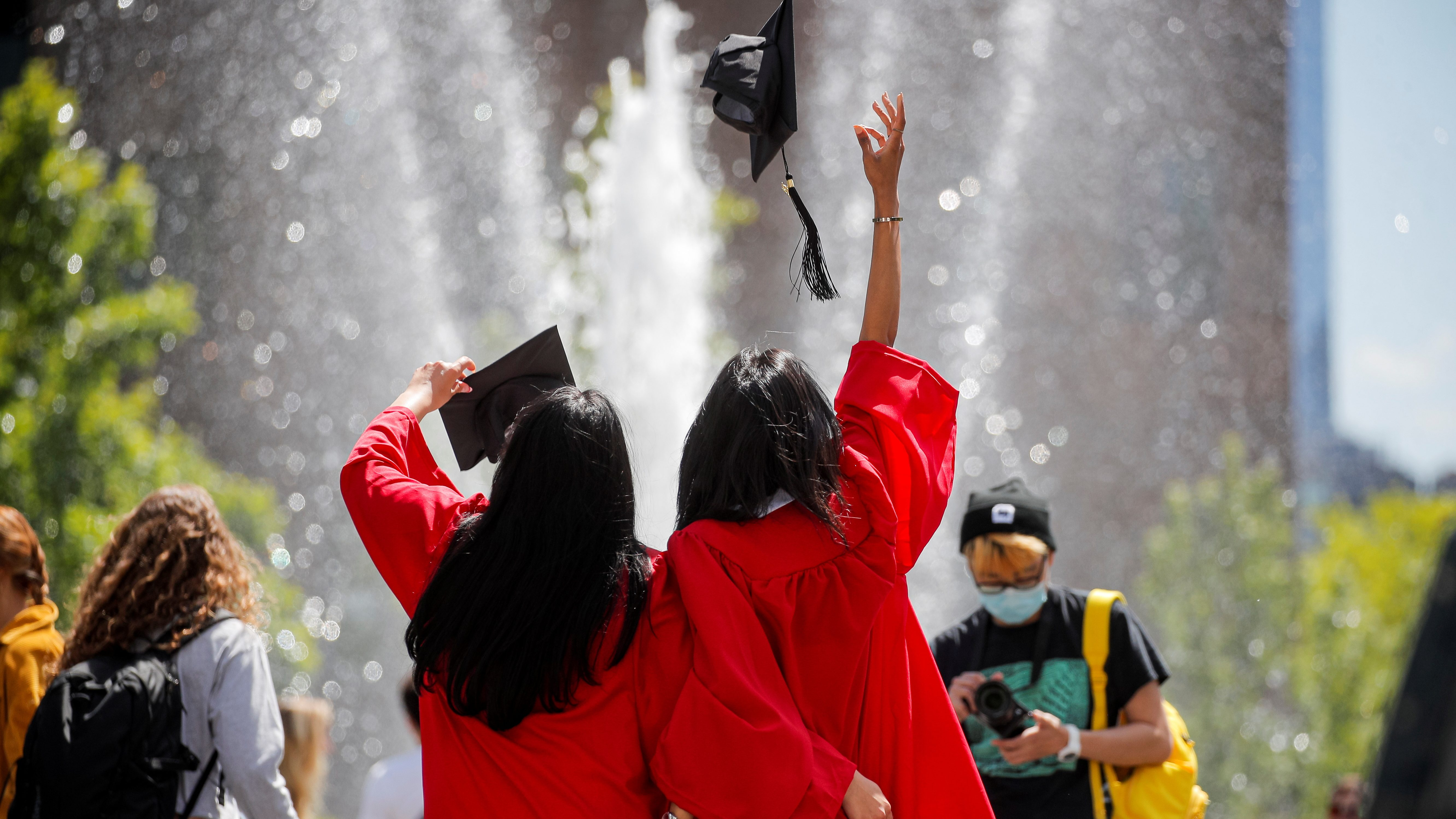 Graduates of The New School pose together in Washington Square Park in New York