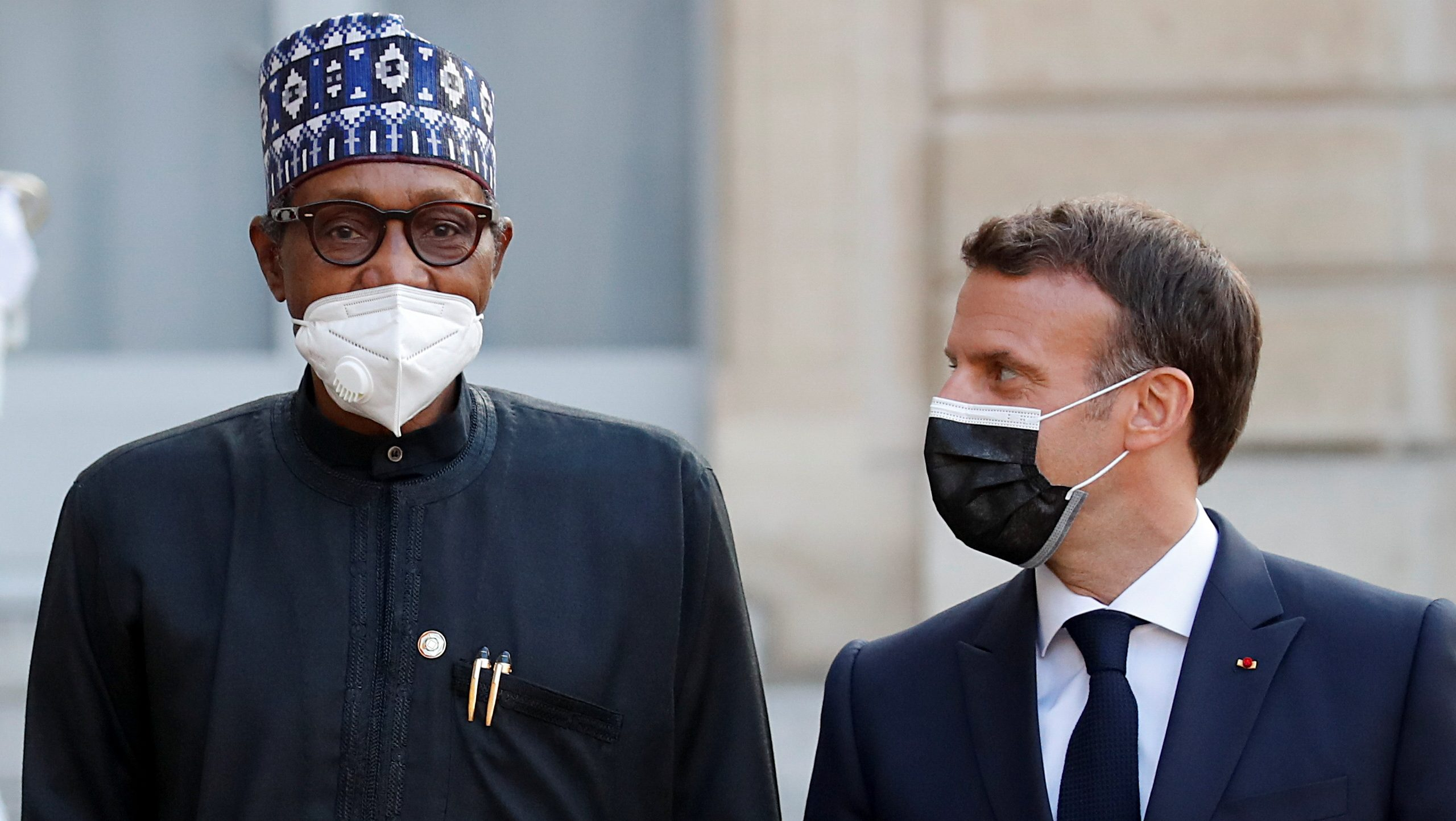 French President Emmanuel Macron welcomes Nigerian President Muhammadu Buhari for a dinner with leaders of African states and international organisations on the eve of a summit on aid for Africa, at Elysee Palace in Paris on May 17.