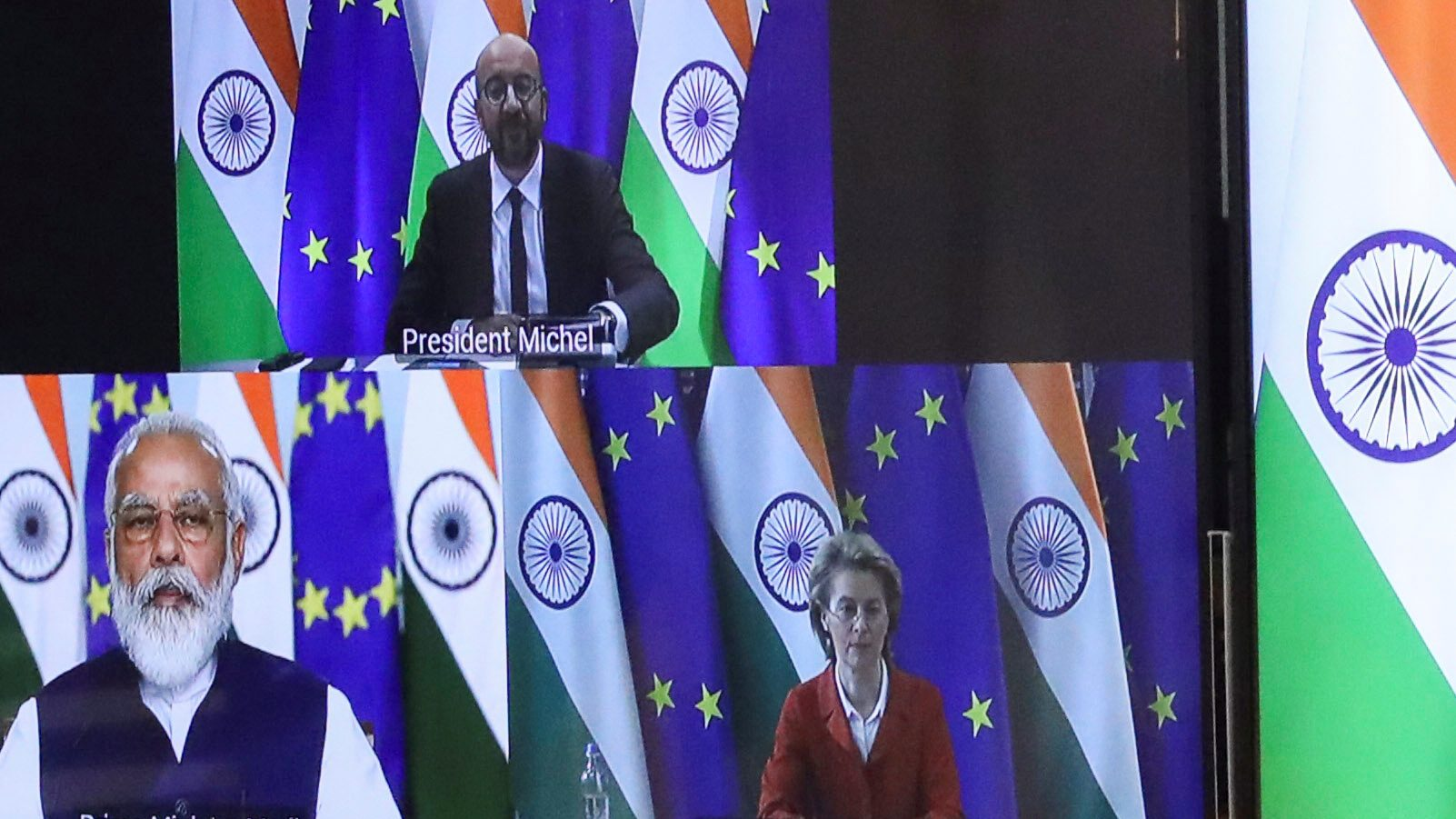 Modi and EU leaders are seen on a video screen