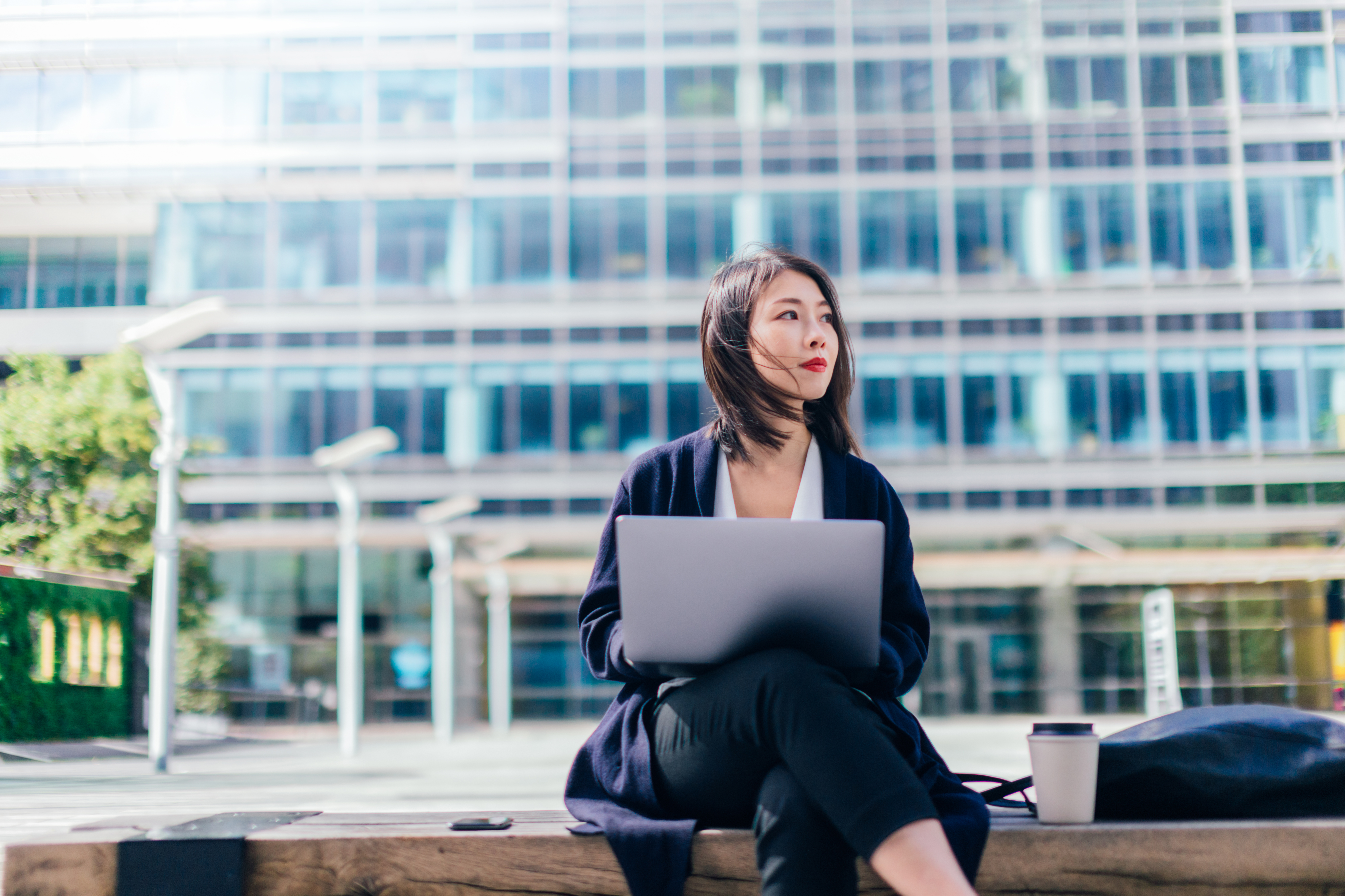 Confident Businesswoman Working With Laptop In The Financial District