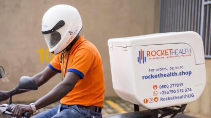 A man on a motorcycle with equipment for a telemedicine service called Rocket Health.