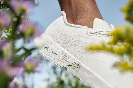 A close up of the Futurecraft.Footprint on a woman's foot as she jaunts through a field