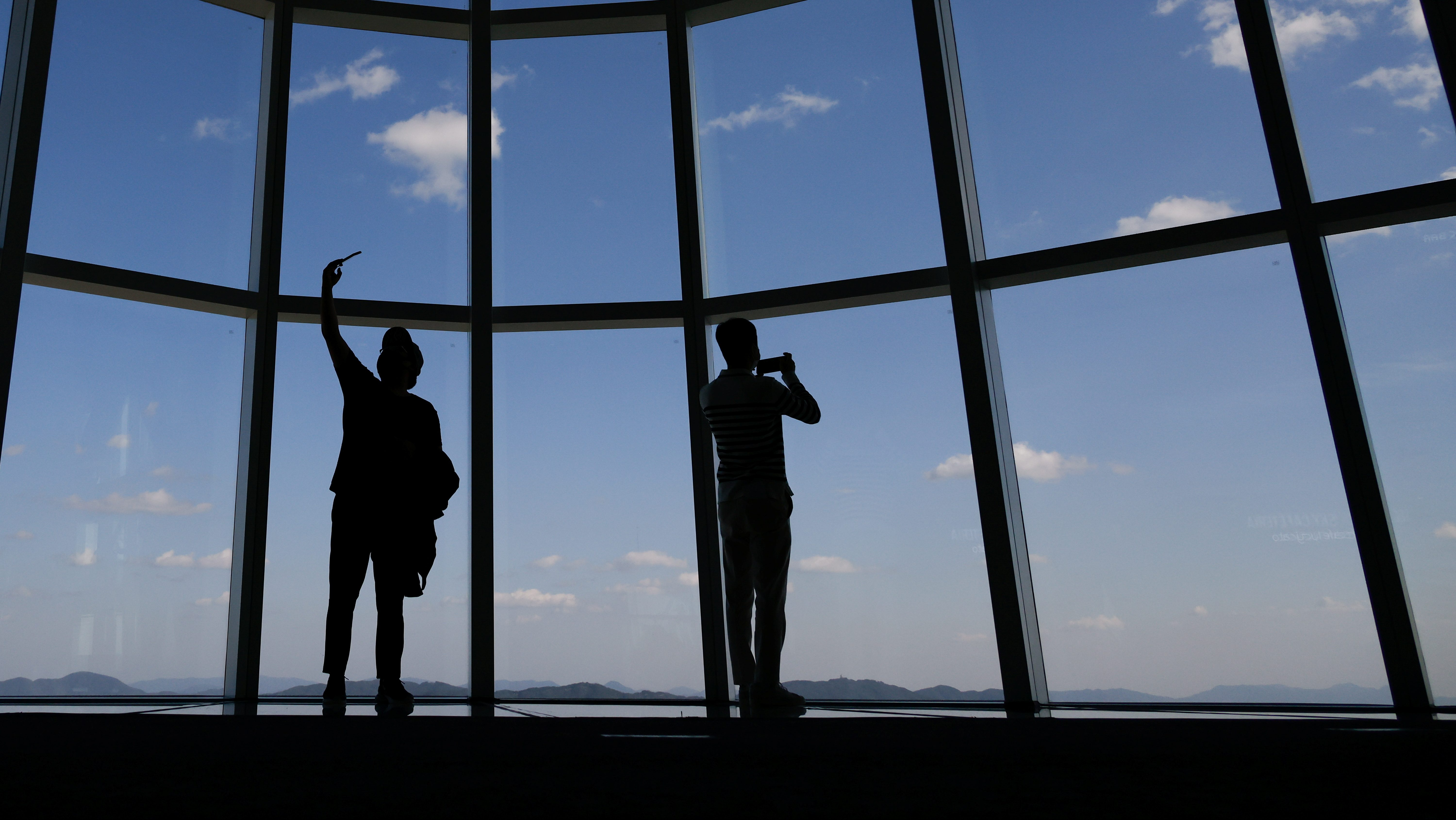 Visitors take a selfie at the Seoul Sky Observatory in Seoul, South Korea