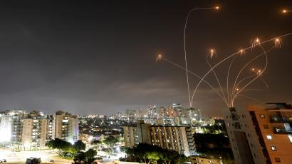 Streaks of light are seen as Israel's Iron Dome anti-missile system intercepts rockets launched from the Gaza Strip towards Israel
