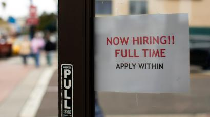 A retail store advertising a full time job on its open door in Oceanside, California