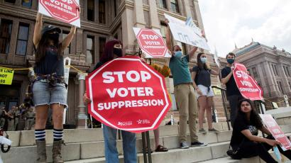Voting rights activists protest against potential new voting restrictions in Austin, Texas.