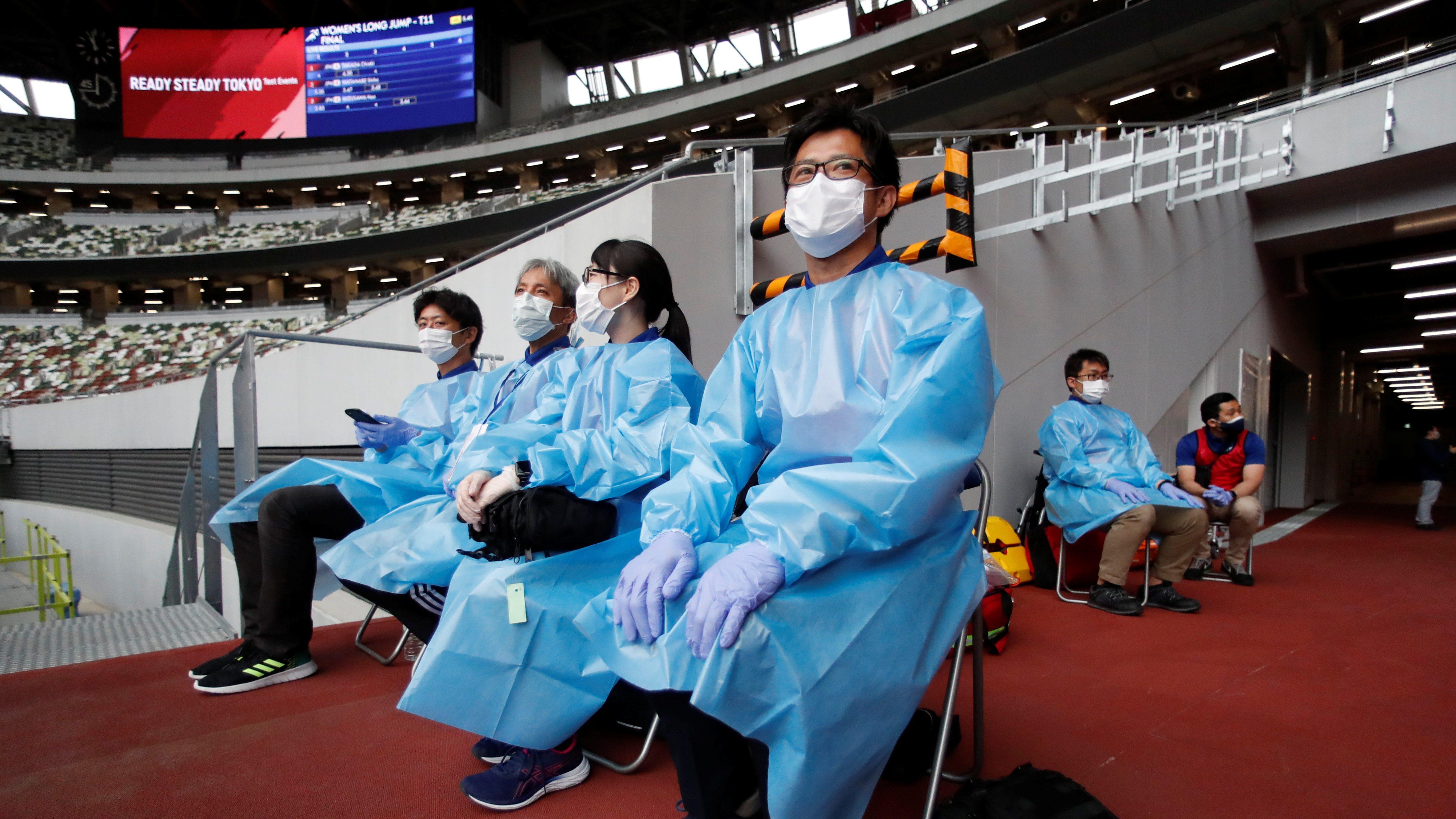 Tokyo 2020 staff members in PPE