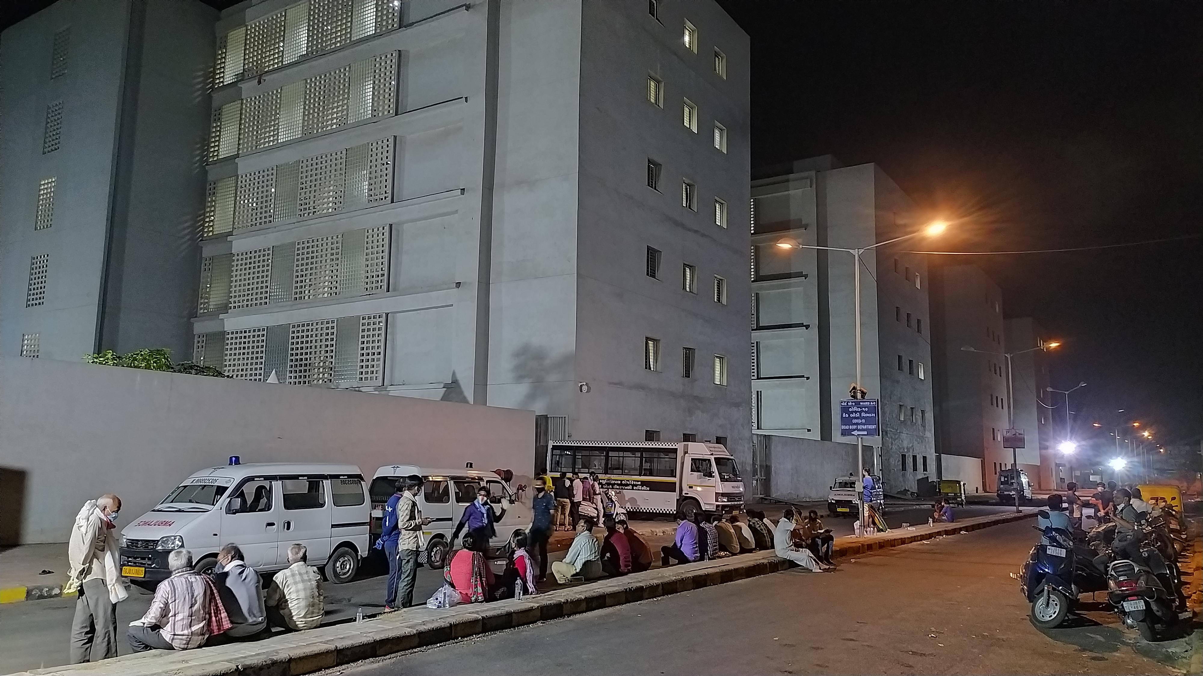 Relatives waiting outside Ahmedabad Civil Hospital