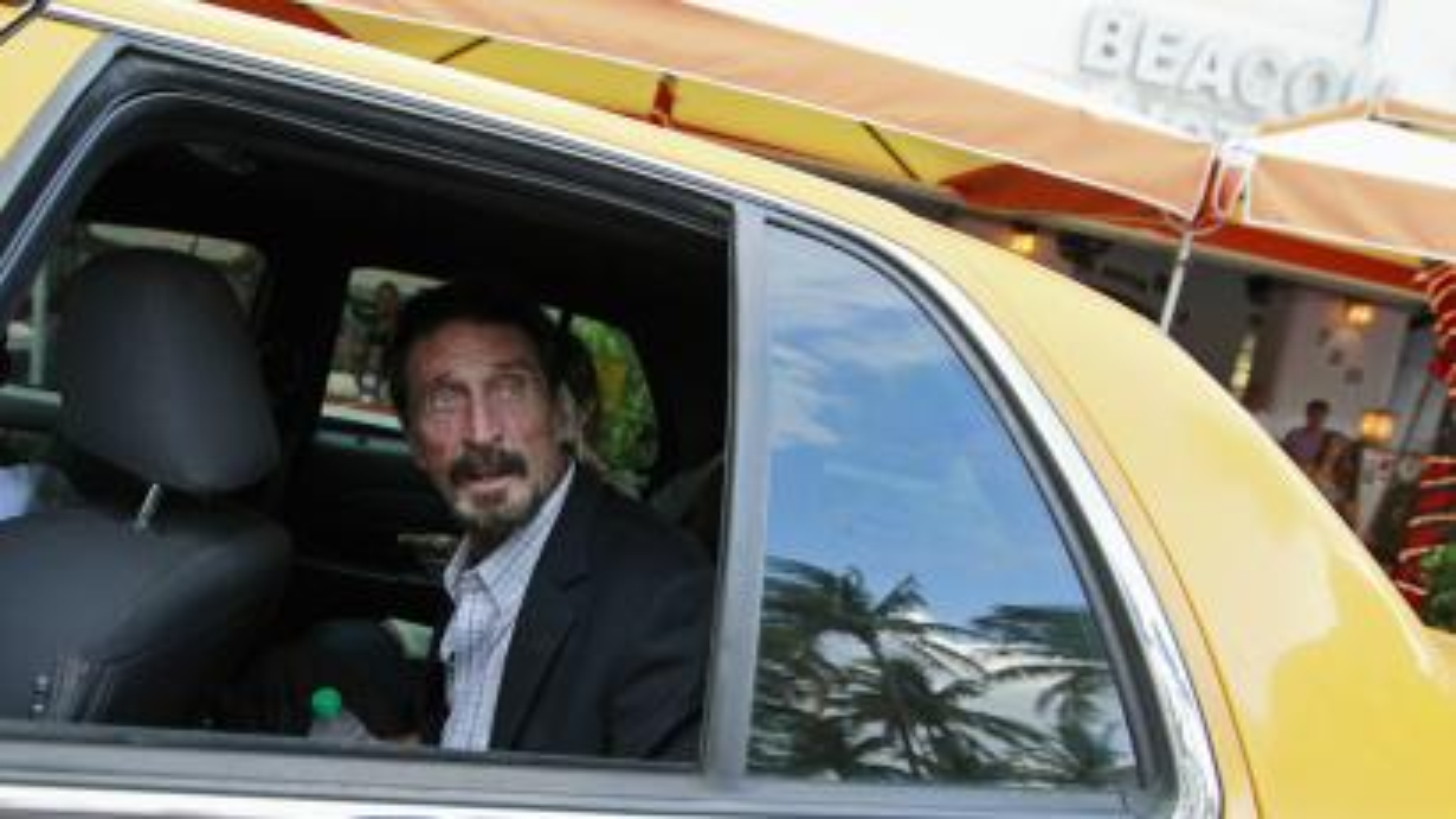 John McAfee in a cab