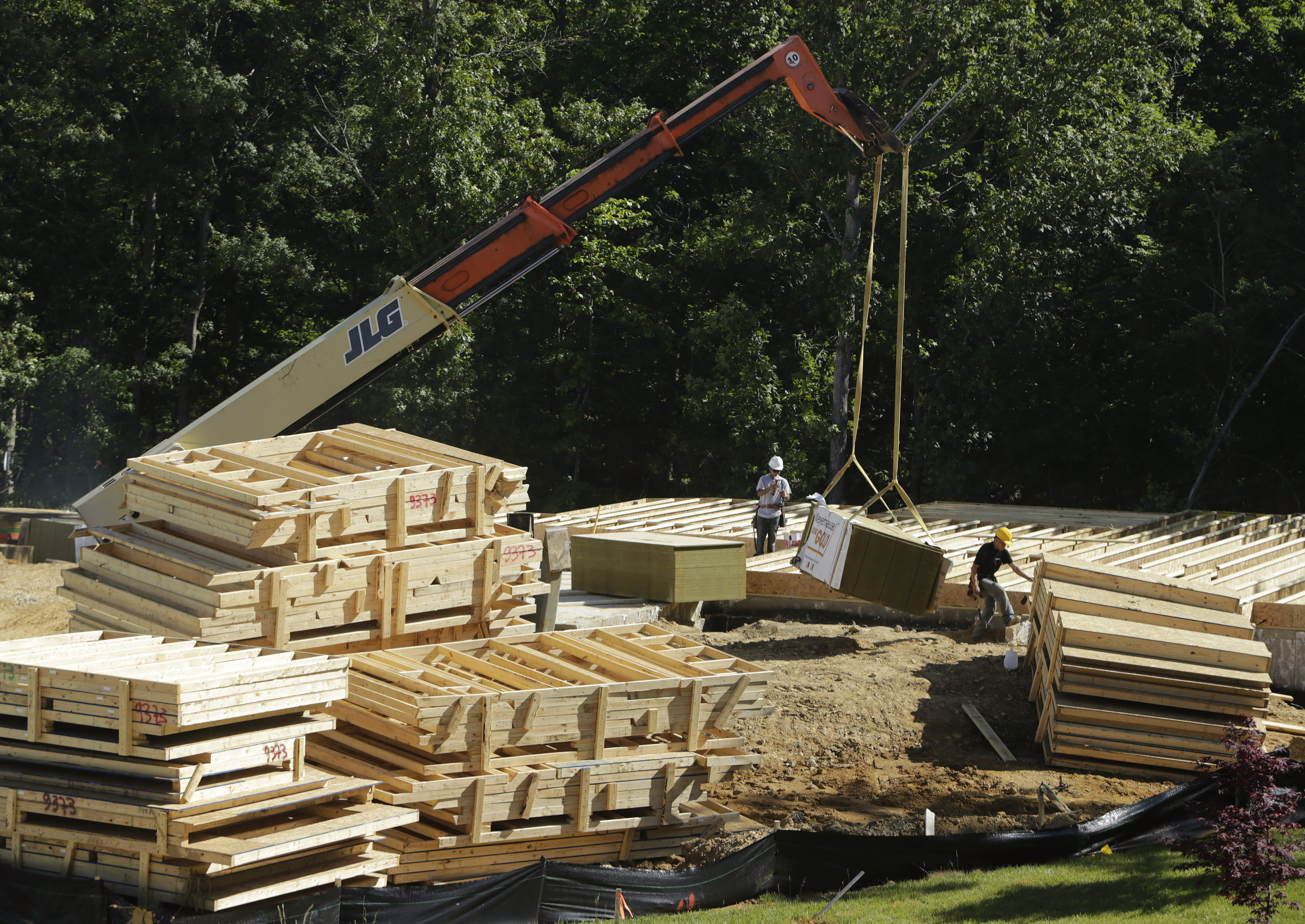Carpenters place plywood flooring at a building site of Mid-Atlantic Builders' 'The Villages of Savannah' in Brandywine