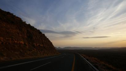 The sun sets over a road near Graaff Reinet in the Karoo October 11, 2013.