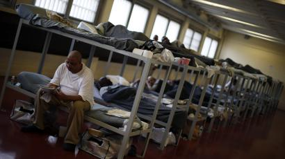 A detainee sits in his bunk in a minimum security dorm to house people with mental health issues at the Cook County Jail in Chicago