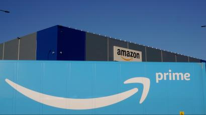 The logo of Amazon Prime Delivery is seen on the trailer of a truck outside the company logistics center in Lauwin-Planque, northern France.