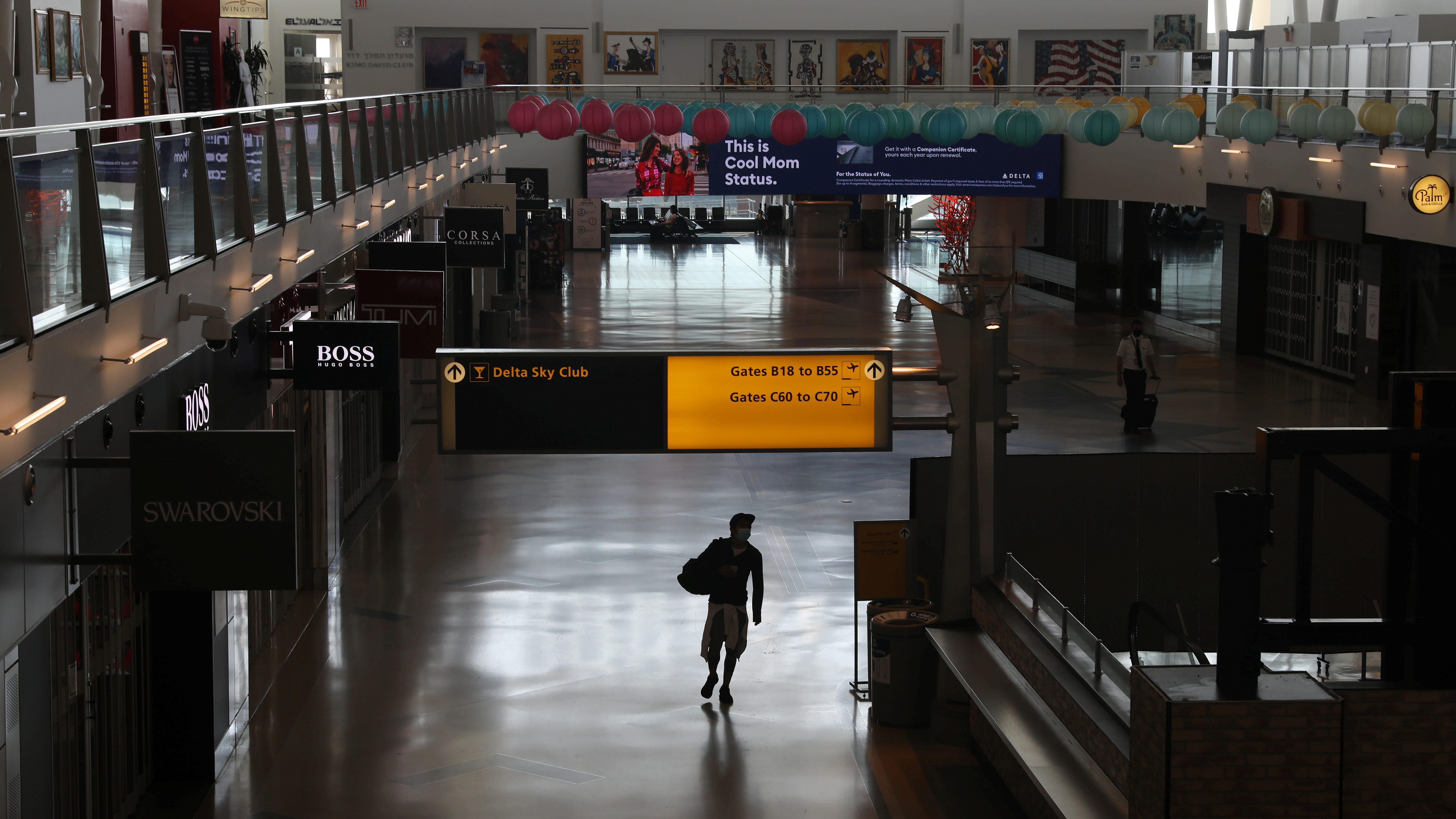 An air traveler walks through a terminal as the coronavirus disease (COVID-19) outbreak continues, at New York's JFK International Airport in New York, U.S., May 15, 2020. REUTERS/Shannon Stapleton
