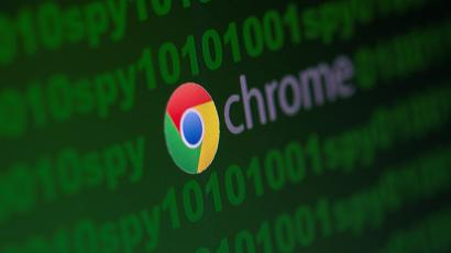"""Google Chrome logo is seen near cyber code and words """"spy"""" in this photo illustration."""