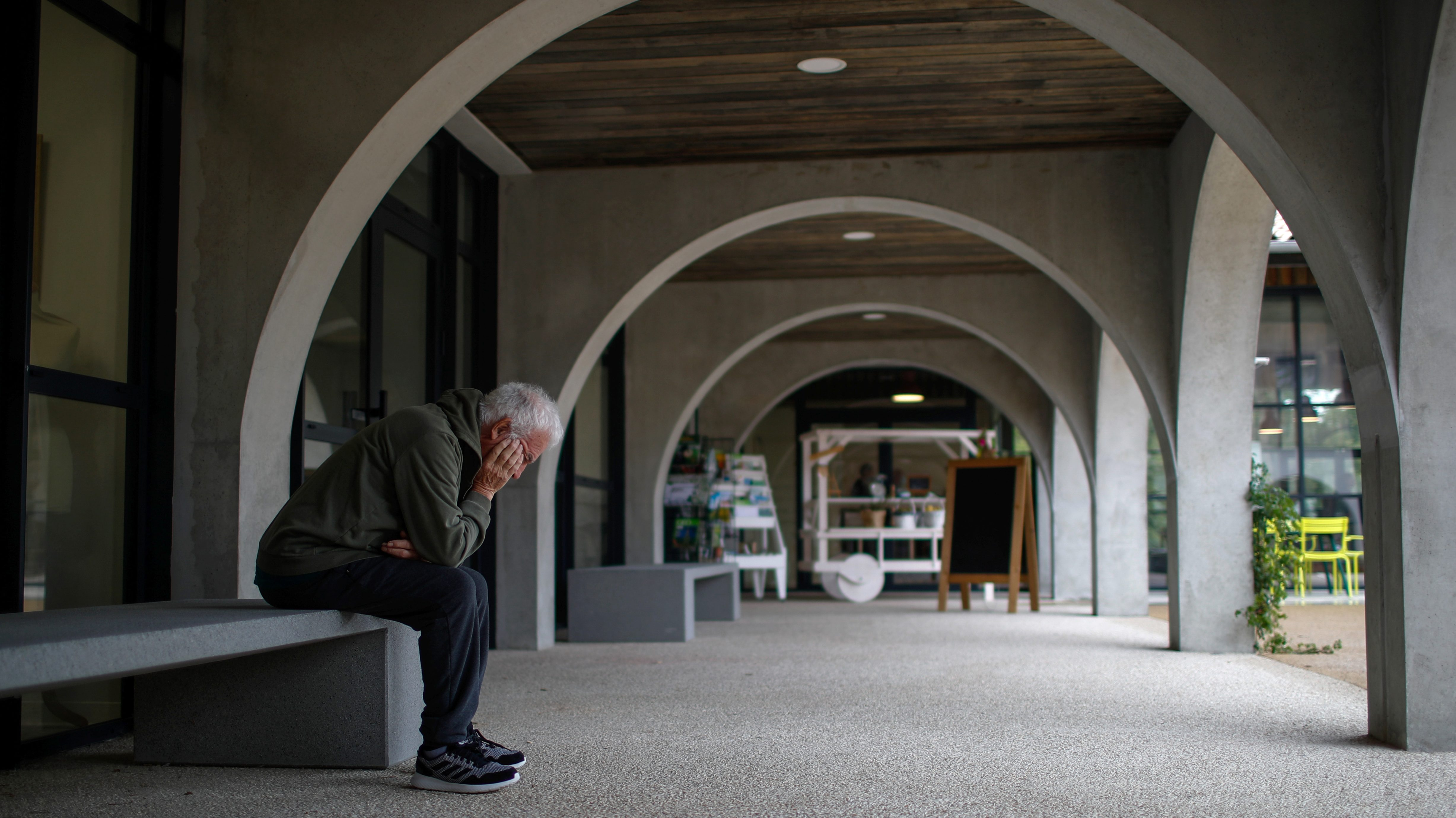 Alzheimer's patient rests on a bench