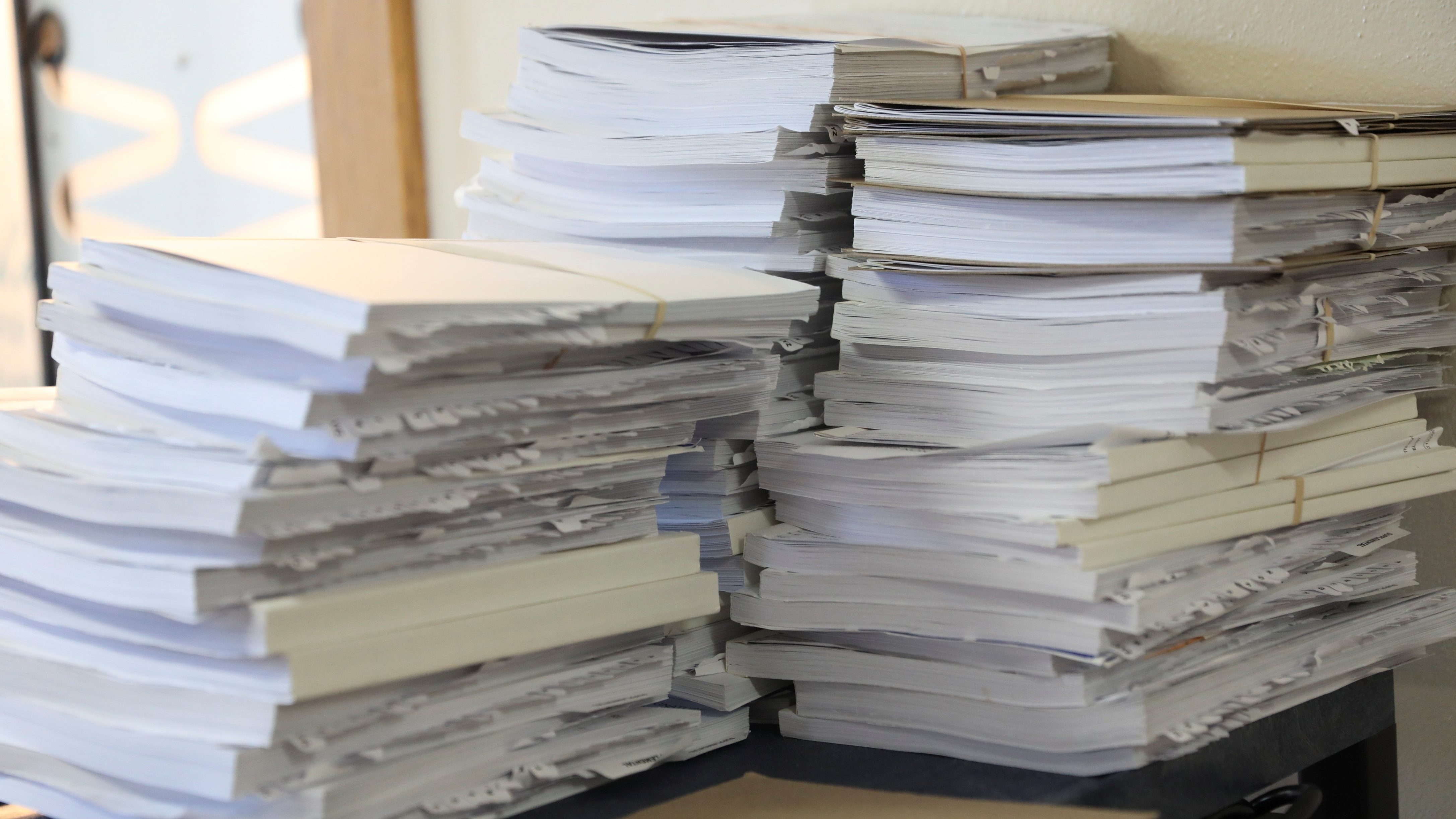 A stack of voter signature books