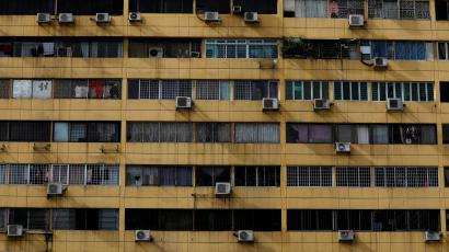 Air-conditioning units dot the facade of People's Park Complex condominium in Singapore