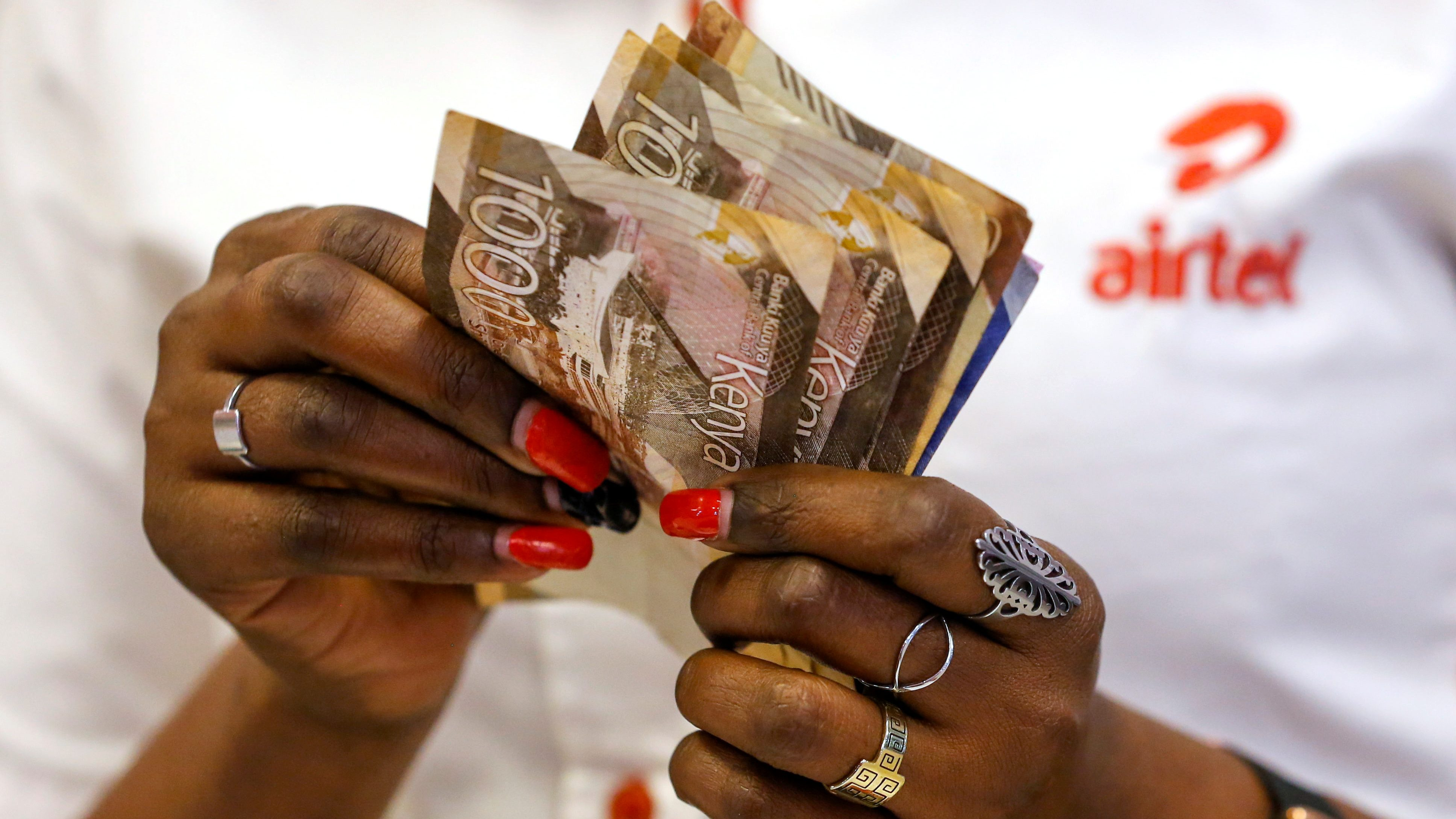 An employee counts money inside a mobile phone service centre operated by Kenyan telecom operator Airtel Kenya in January.