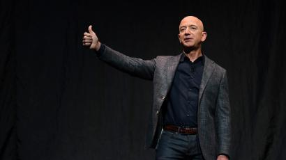 Amazon's Jeff Bezos gives a thumbs up as he speaks during an event about Blue Origin's space exploration plans in Washington in 2019.