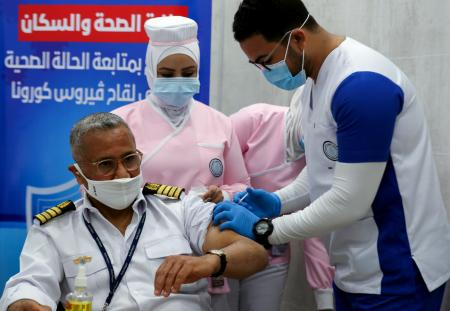 A member of Suez Canal captains receives a Covid-19 vaccine in Ismailia in April.