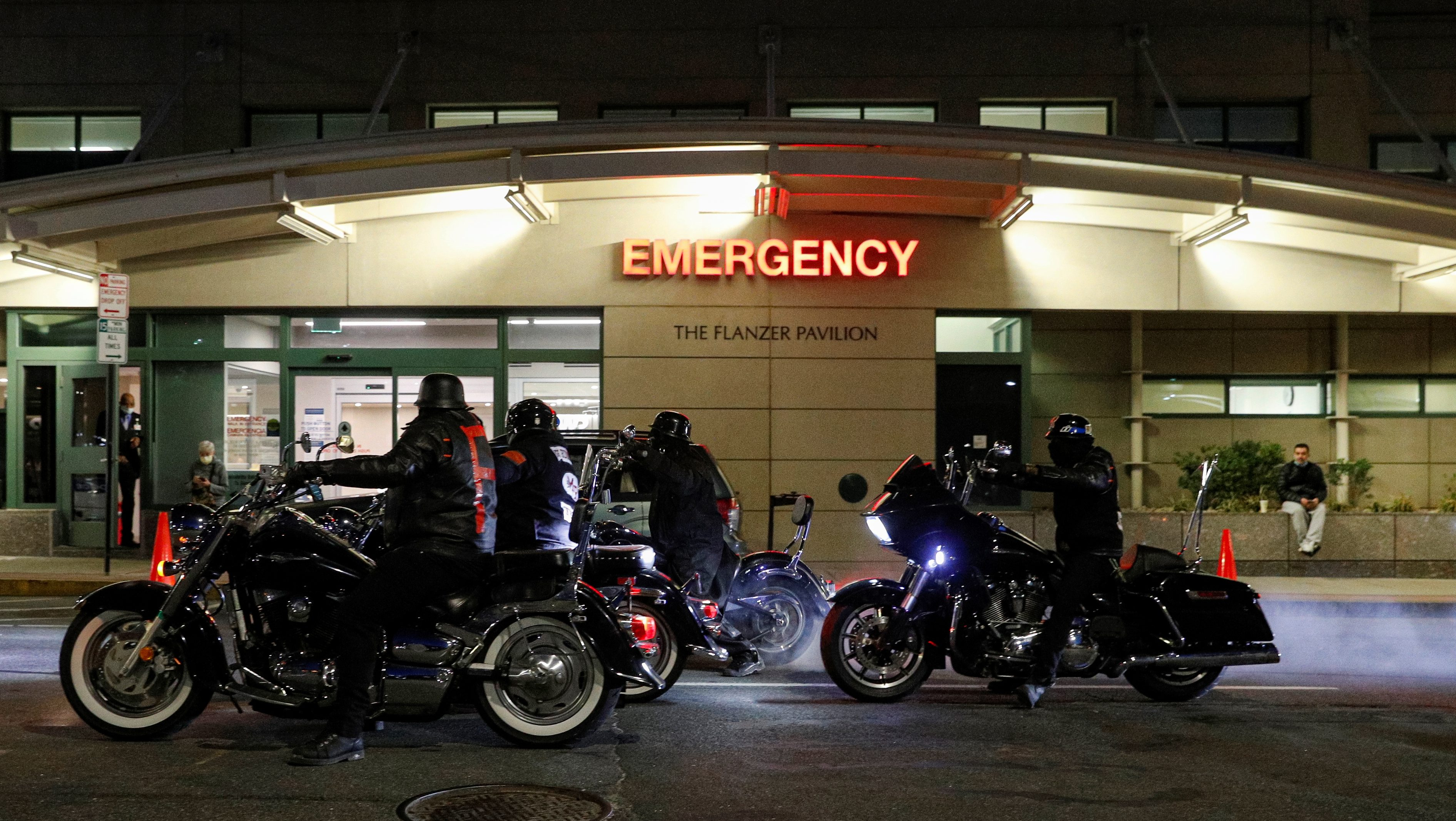 Members of a Motorcycle club perform a burn out during a vigil for musician and actor DMX outside White Plains Hospital in White Plains, New York