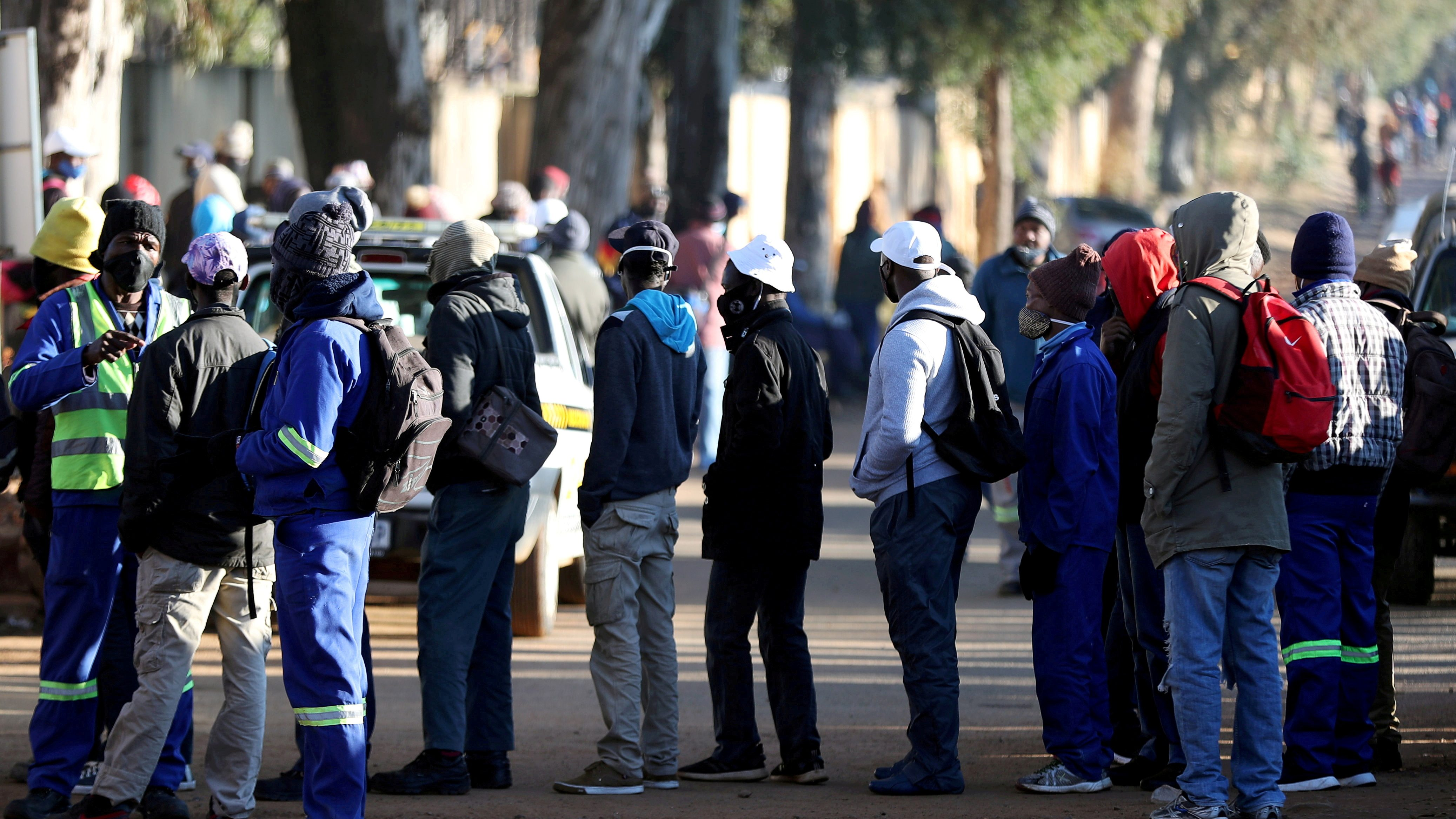 Job seekers stand outside a construction site in Johannesburg.
