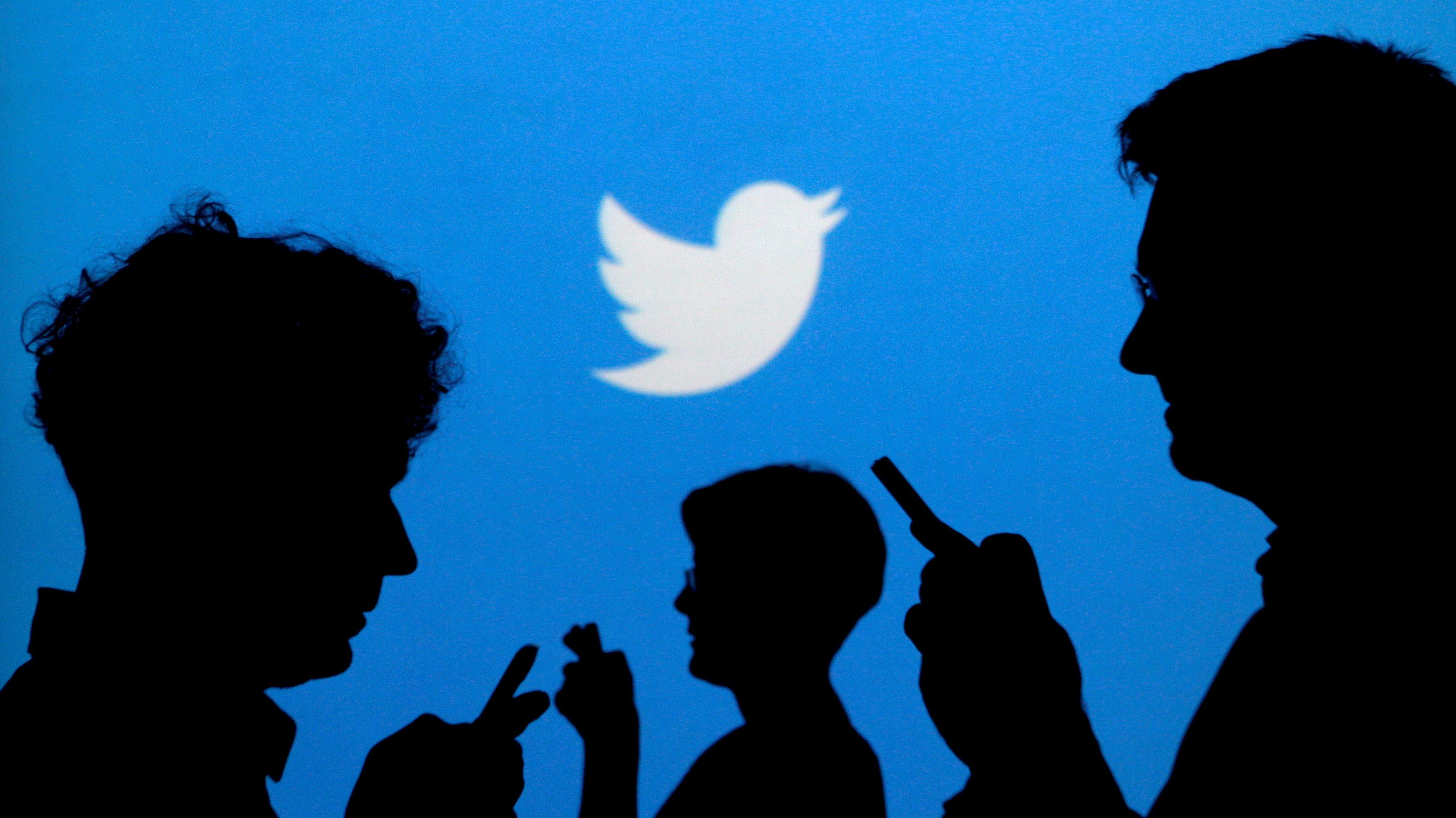 People tweeting on smartphones.