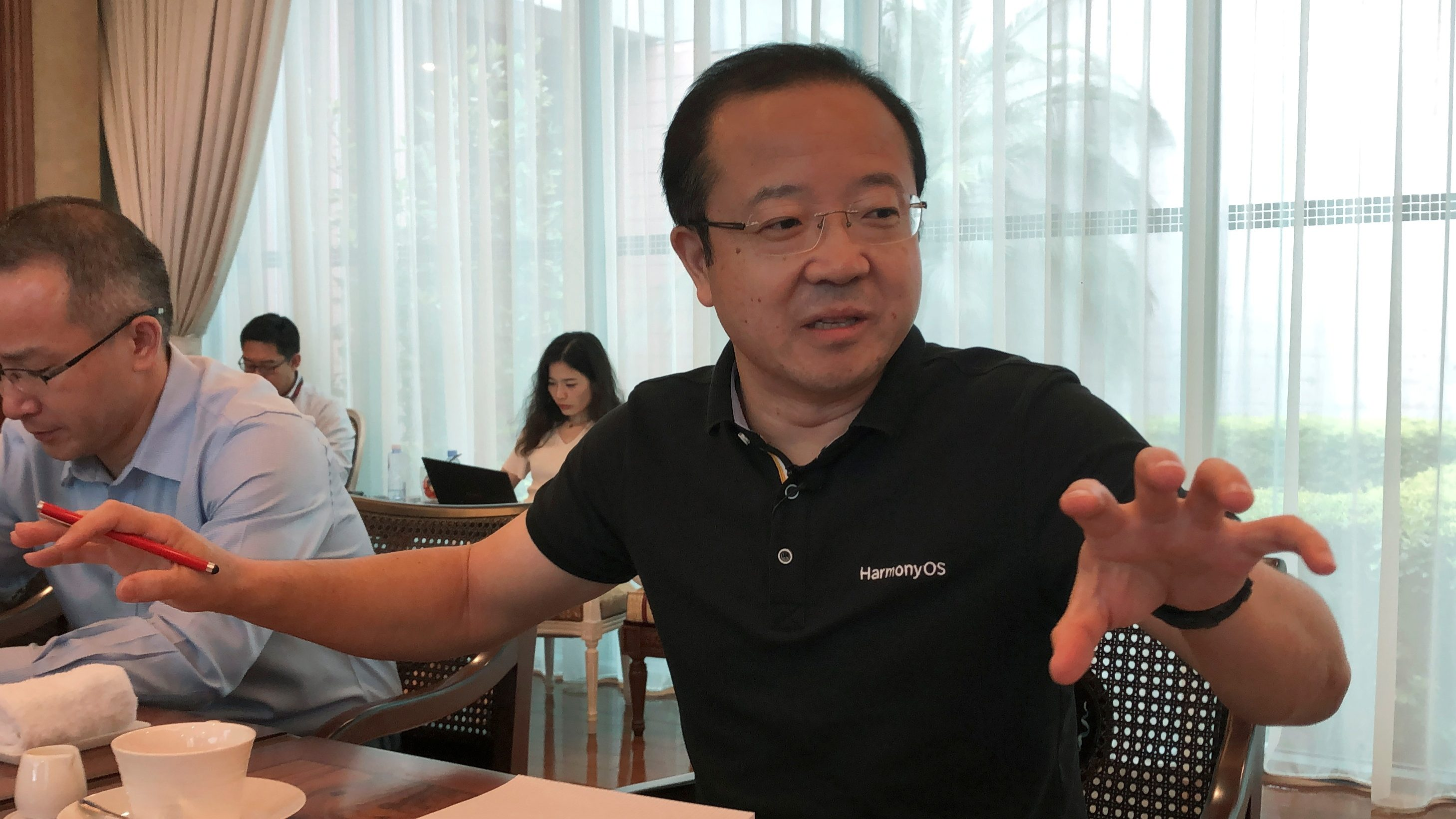 Wang Chenglu, president of Huawei Consumer Business Group's Software Department, talks about the HarmonyOS operating system during a media roundtable at the Huawei headquarters in Shenzhen