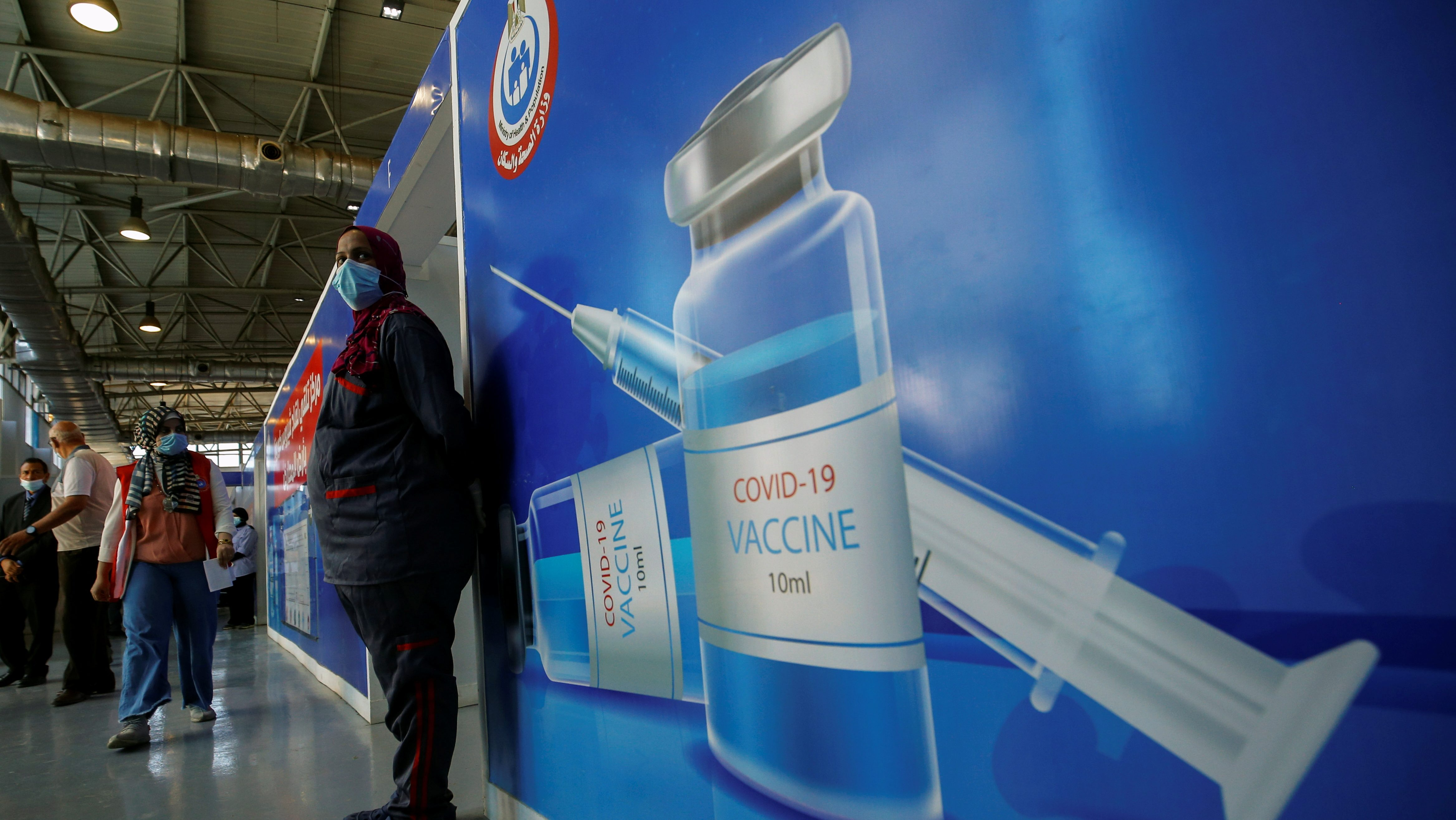 People wait to receive a shot of the COVID-19 vaccine at a mass immunization venue inside Cairo's International Exhibition Center in Cairo on June 2.