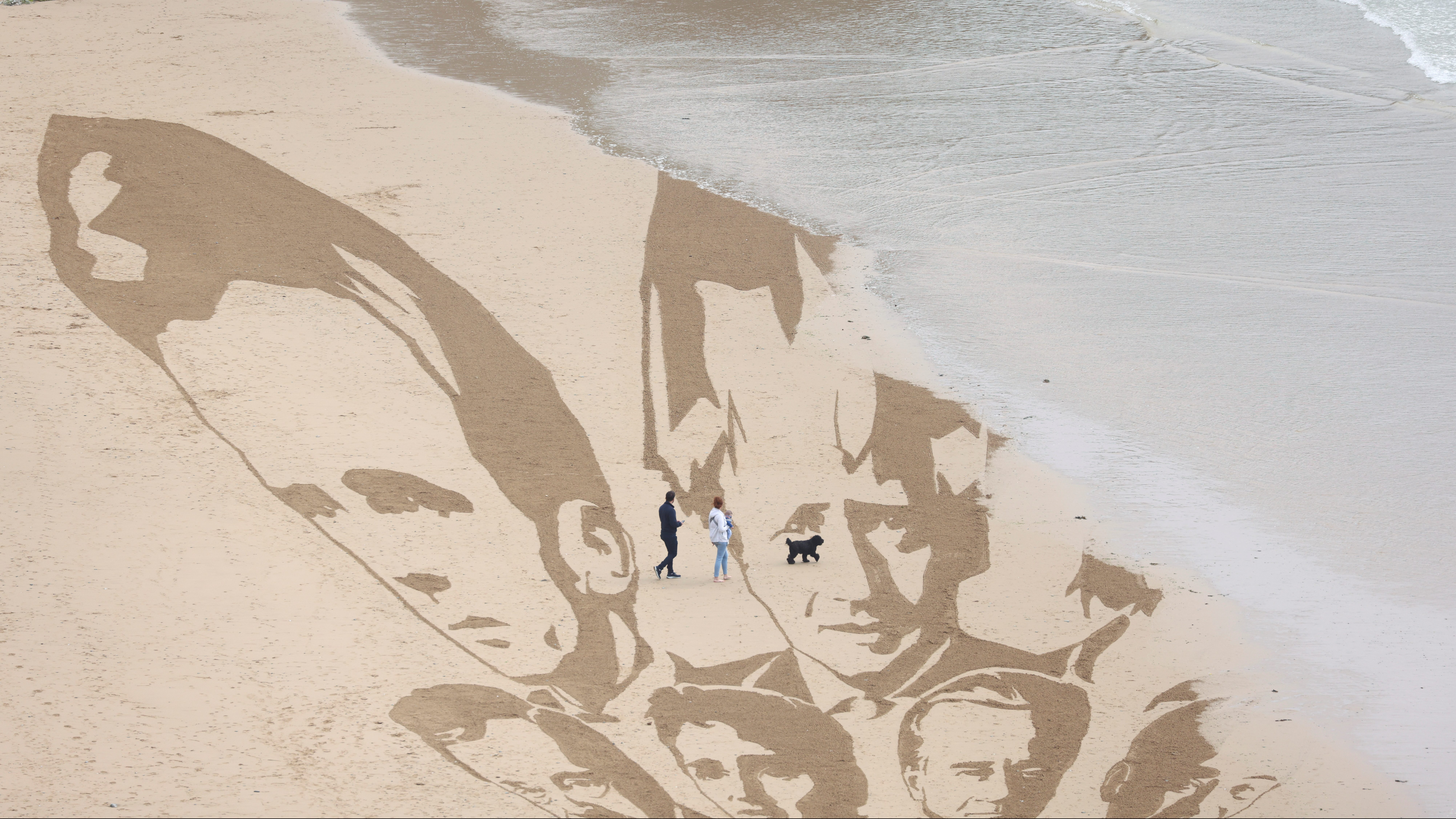 Campaign group Avaaz create a giant beach sand artwork depicting the faces of the G7 leaders