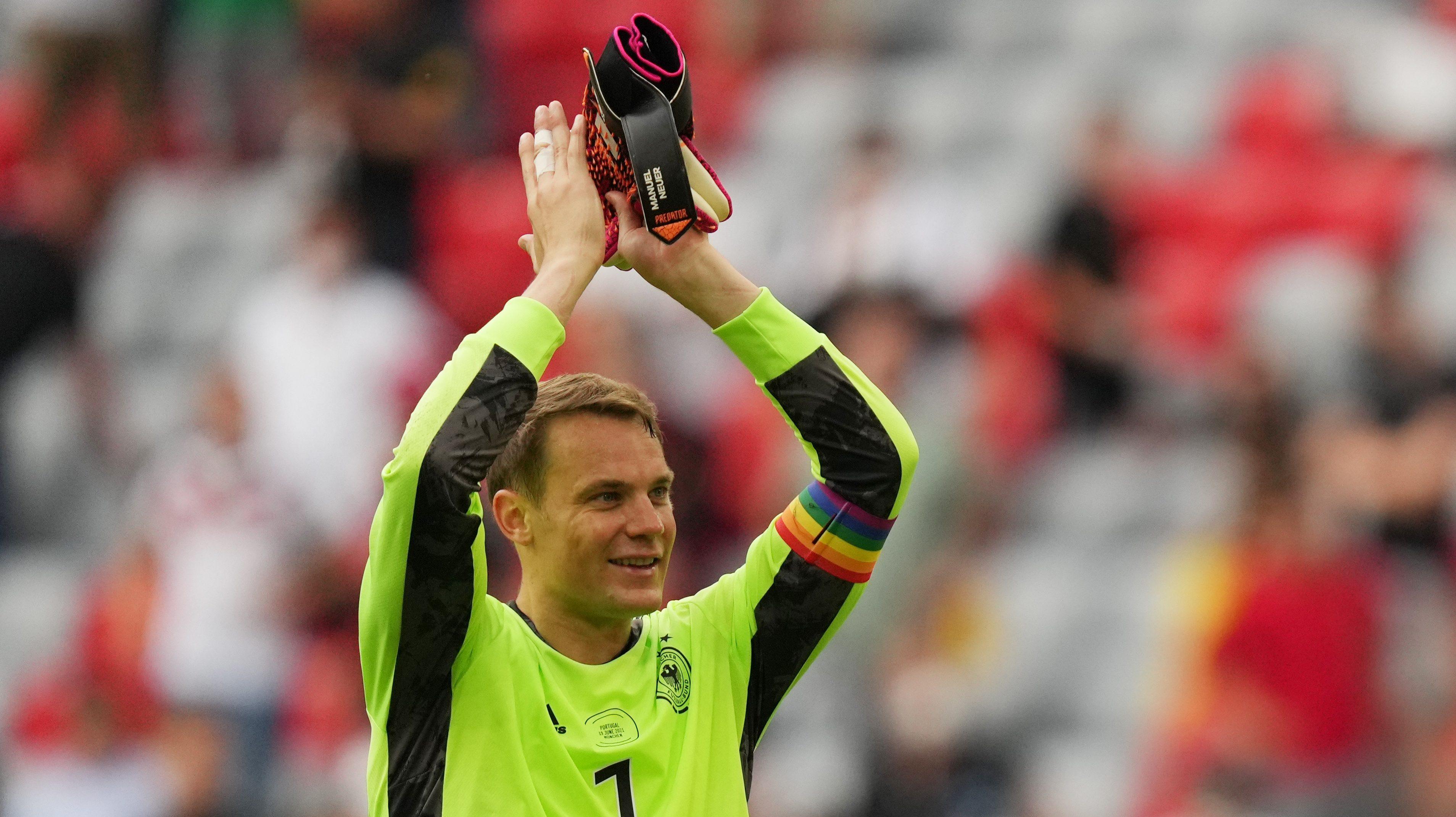 Germany's Manuel Neuer applauds fans