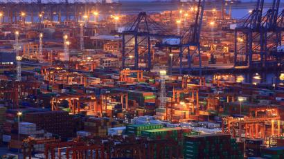 Shipping containers are stacked up on the docks and ships at Yantian Port in Shenzhen, China.